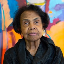 Shirley Woodson in her Detroit studio. A new painting grows in the background.