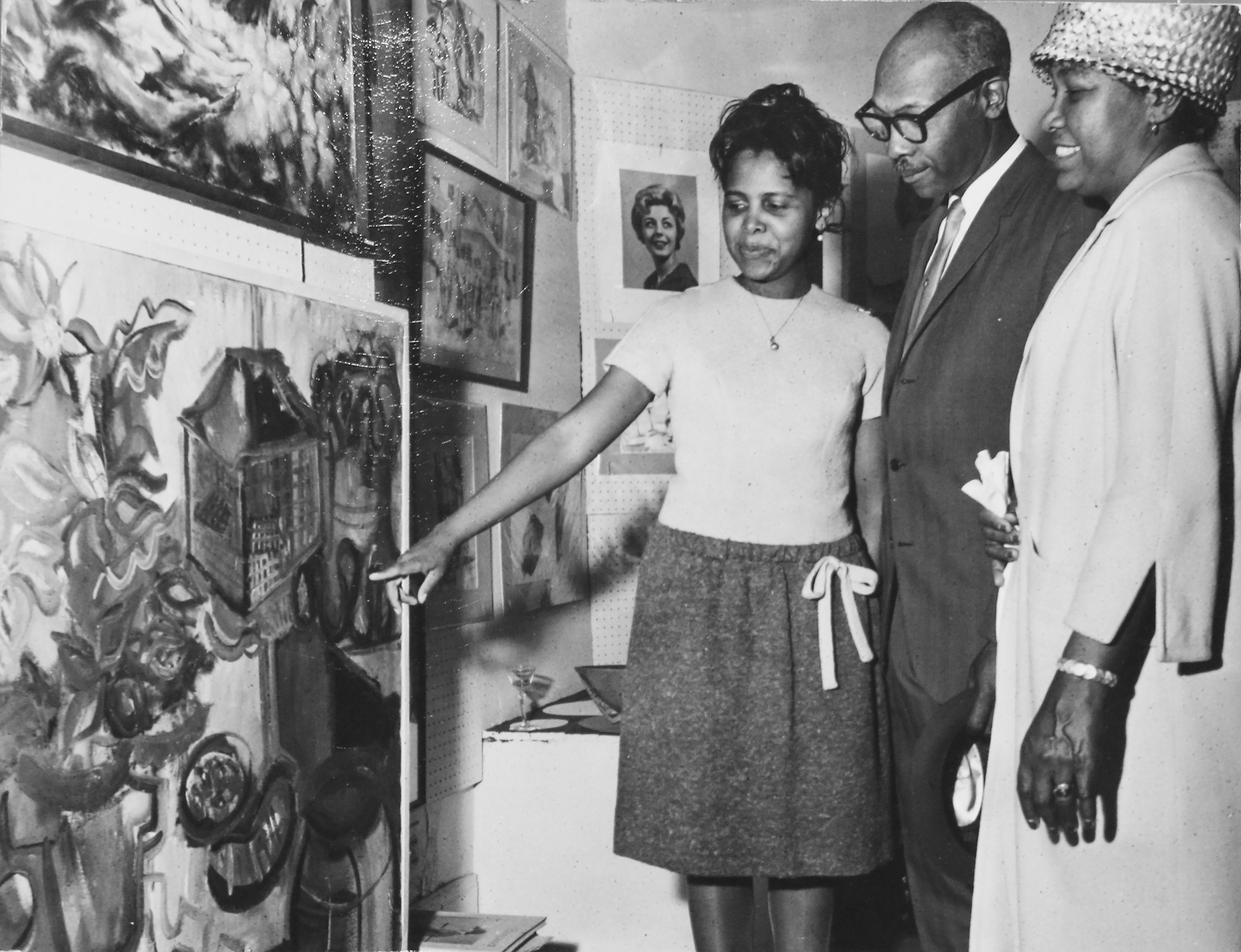Shirley Woodson sharing her work with parents, Claude and Celia Woodson, at Detroit's Arts Extended Gallery in the early 1960s. Photo by James D. Wilson, courtesy Shirley Woodson.